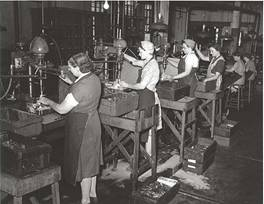 During World War II, women took jobs in area factories by GrandRapidsPublicLibrary.